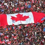 Canadian flag surfing on crowd