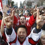 Canadian fans celebrate Canada's victory over the U.S. in the men's ice hockey gold medal game during the Vancouver 2010 Winter Olympics